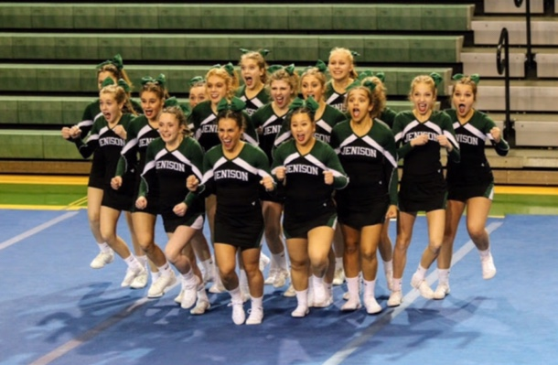 The+Jenison+Varsity+cheer+team+storms+the+judges+in+round+1.