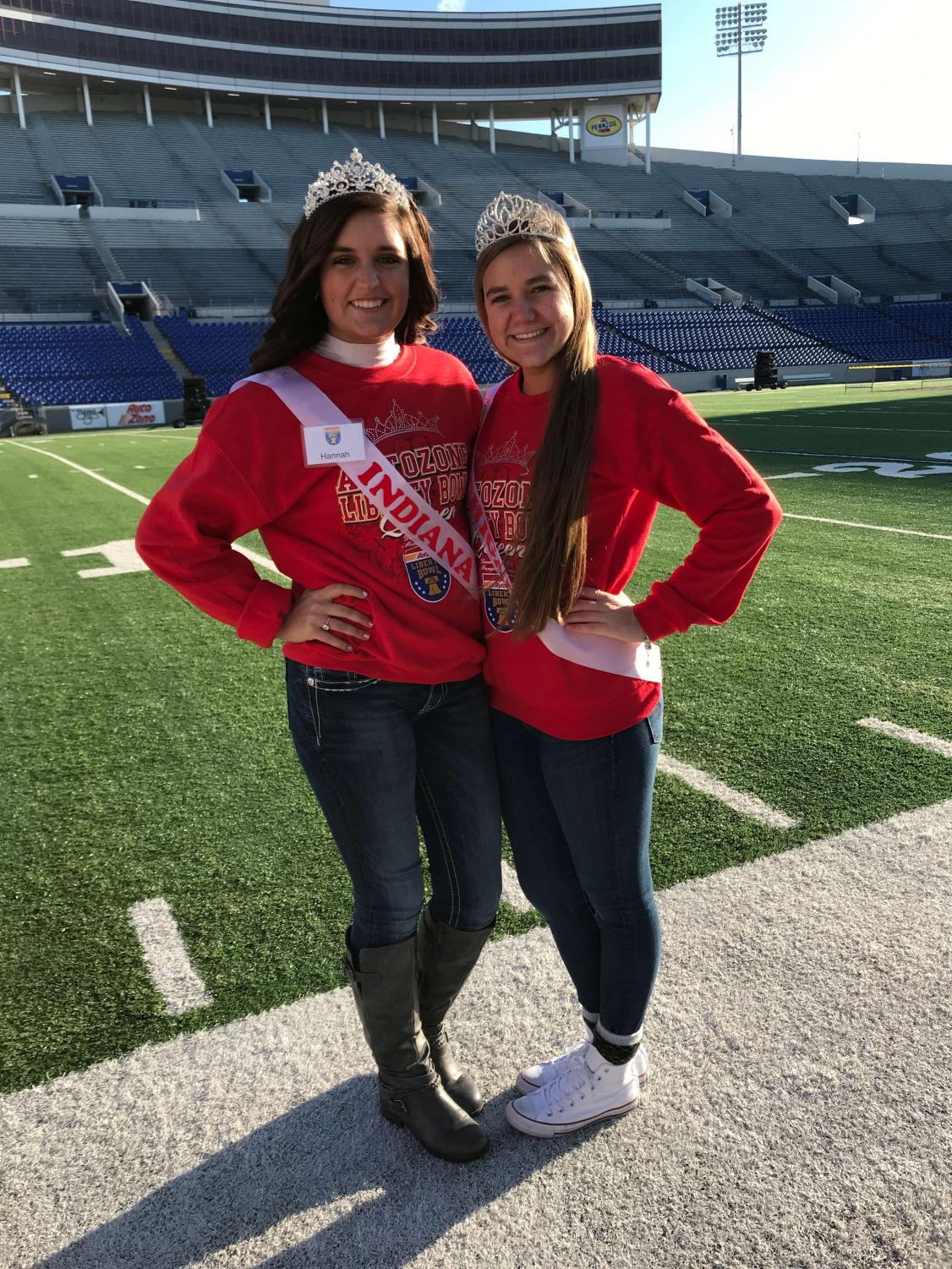 Michigan rep. Maddy Ippel (right) and Indiana rep. Hannah Behm (left) on the field at the 2017 AutoZone Liberty Bowl in Memphis, Tennessee.